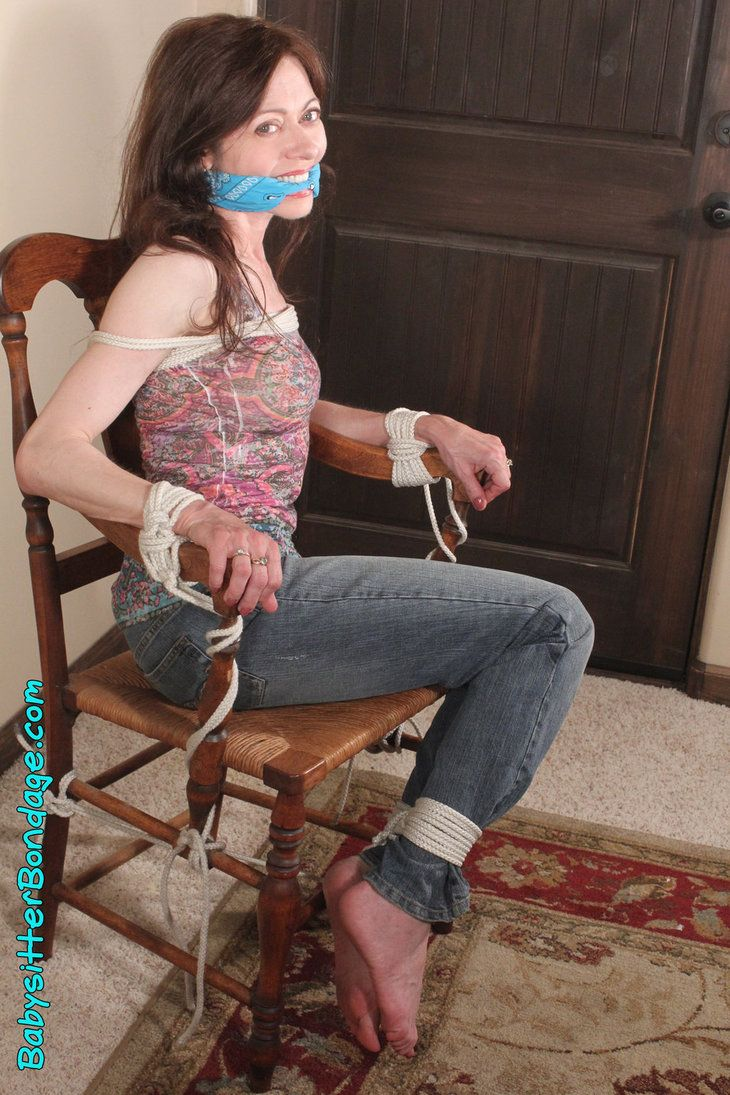 Girl tied up to a chair