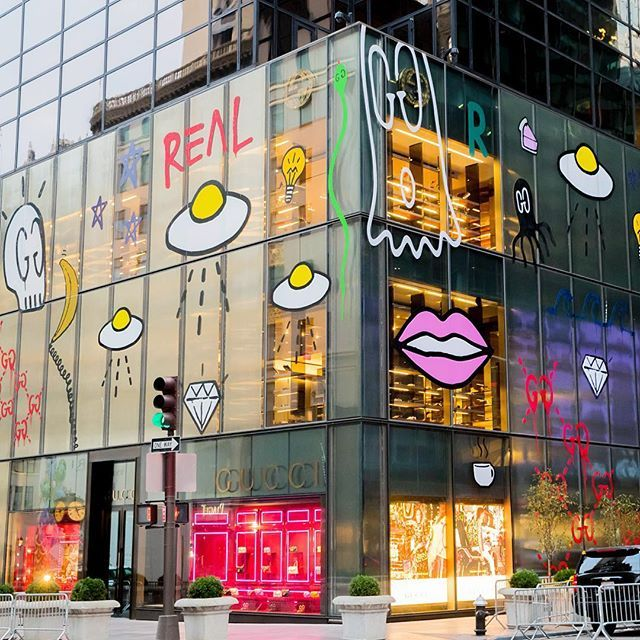 """Graffiti artist Trouble Andrew, also known as #GucciGhost, was given the opportunity to reimagine the front of Gucci's flagship store on New York's Fifth Avenue.  As store design and experiences play an increasingly important role in meeting the desires of today's luxury consumers, read about """"The Store of the Future"""" on businessoffashion.com [Link in bio] : Courtesy of Kevin Tachman for Gucci"""