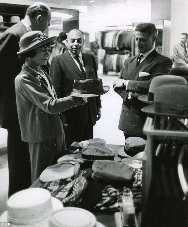 Retail tour: Chanel inspecting a hat on a visit to the Dallas outpost of luxury retailer Neiman Marcus