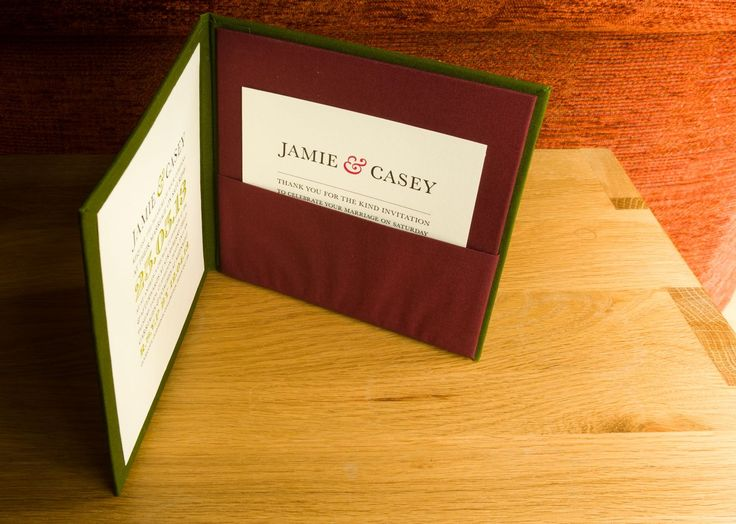 Custom and hand made wedding pocket invitation panel with blind embossed names on the covers.