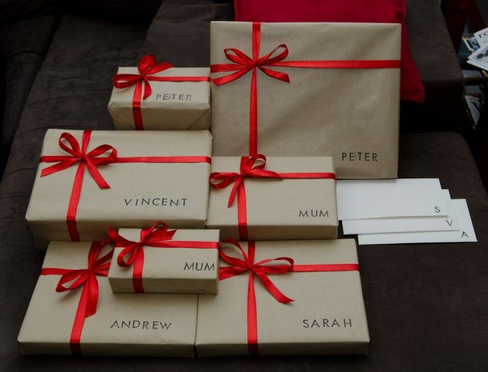 Cut out or Stamp names for gift wrap. Tie with coordinating ribbon.