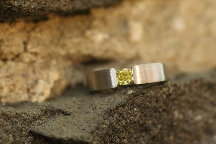 """Fancy Intense yellow cushion cut diamond in our tension set design part of our in-store """"Bluestone Wall"""" photo shoot! #ExceptionalJewels #BlueStoneWallEdition"""
