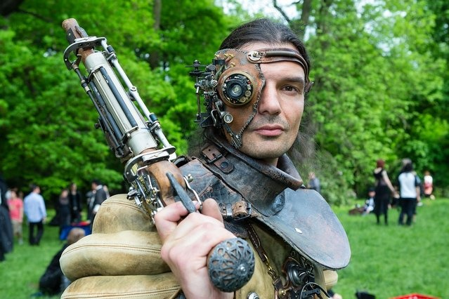 A man dressed as a steam-punk attends the traditional park picnic on the first day of the annual Wave-Gotik Treffen, or Wave and Goth Festival, on May 17, 2013 in Leipzig, Germany. The four-day festival, in which elaborate fashion is a must, brings together over 20,000 Wave, Goth and steam punk enthusiasts from all over the world for concerts, readings, films, a Middle Ages market and workshops. (Photo by Marco Prosch)