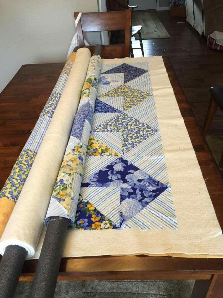 Pin & roll layers onto 3 pieces of foam pipe insulation, then unroll as you hand-baste your layers together!