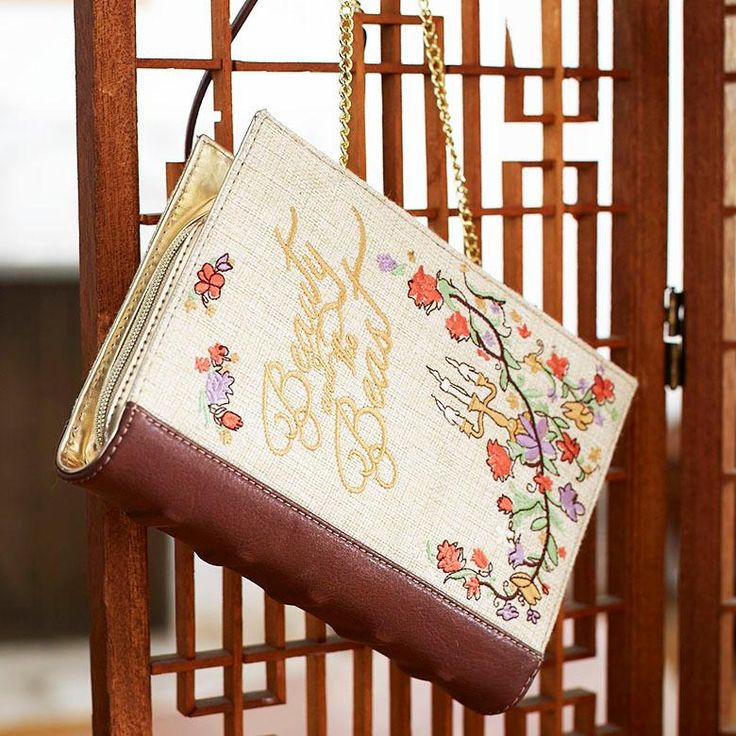 Be our guest to this new bag | Danielle Nicole Disney Beauty And The Beast Book Clutch