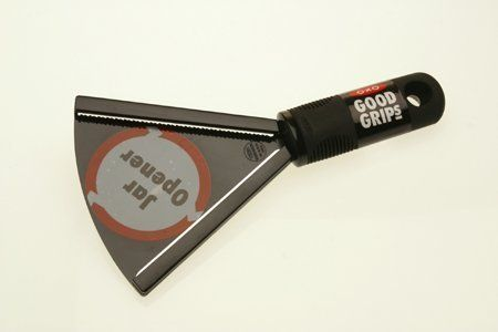 """Comfortable, built-up handle helps open stubborn lids easily. The patented Good Grips® handle on this jar opener provides a flexible, nonslip grip when removing twist-off lids from jars and bottles. Two metal grip strips allow for easy removal of lids ranging from 1/2"""" to 3-3/4"""" in diameter."""