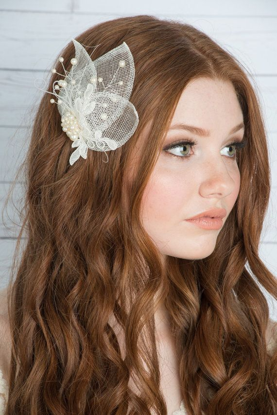 "considered a ""fascinator"", but I think it would be pretty with a veil of any kind."