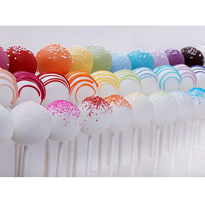 Brides: Rainbow Wedding Cakes for Summer :Cake pops frosted in every color under the sun are an unexpected dessert or take-home favor.