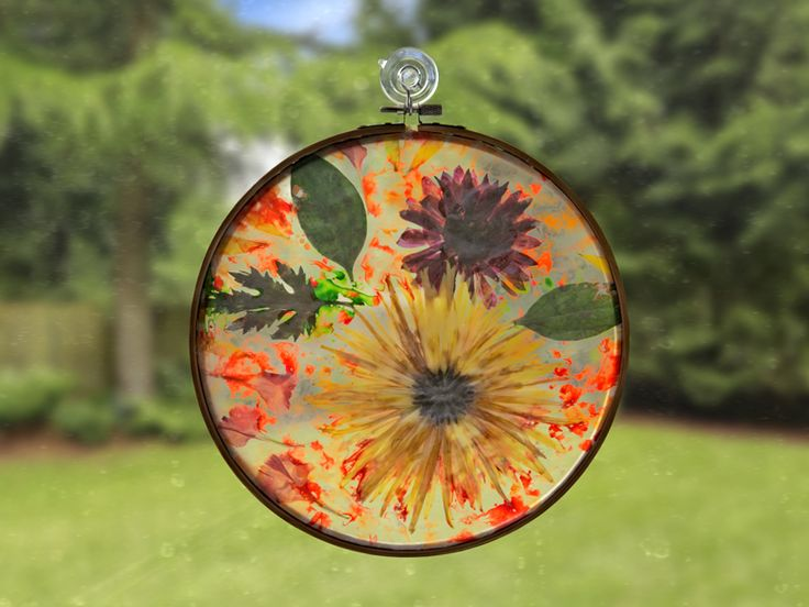 The problem with fresh flowers is that they eventually wither. The solution is to press them. Pressed flowers can be used in a wide variety of projects, including this easy craft that creates a beautiful stained glass effect. Materials:  flowers wax paper crayon shavings iron a frame of your choice (such as a floating frame, embroidery hoop, or homemade Popsicle frame)  Instructions:  Press the flowers by placing them between two sheets of absorbent paper and topping them with heavy objects…