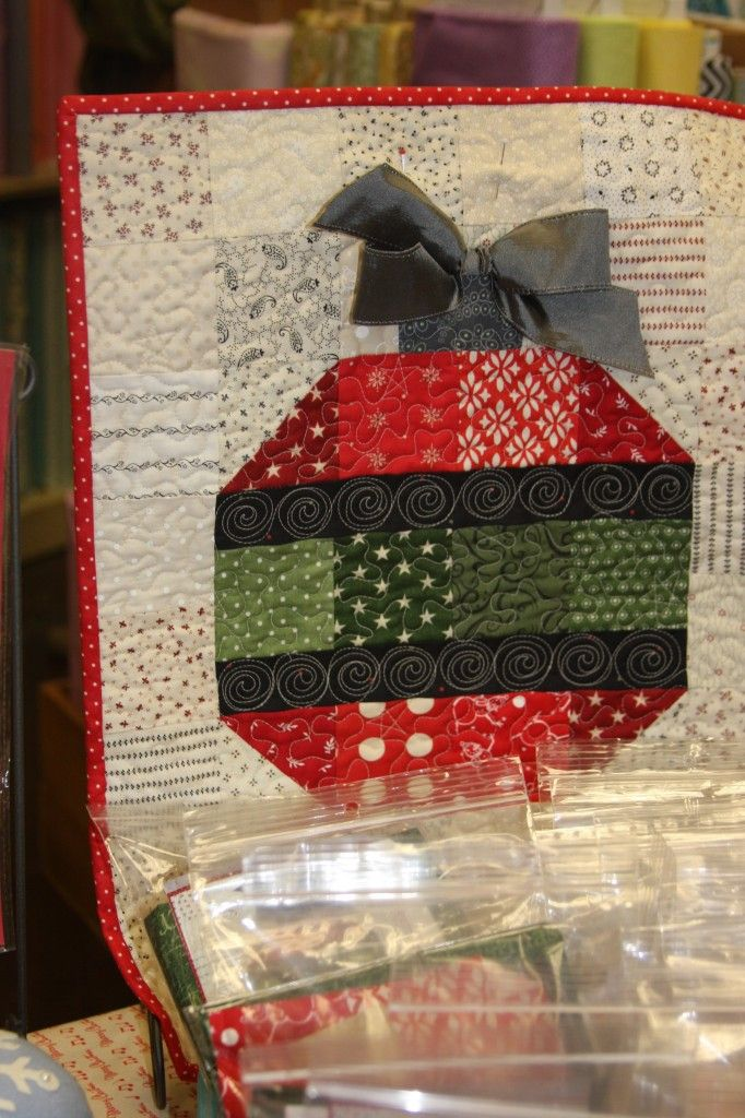 Quilted Ornament Wall Hanging. Would make a nice table runner.