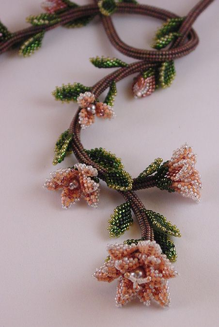 Cascading Flowers by June Huber. Materials used: 8/0, 11/0, 15/0 Japanese seed beads; Japanese cylinder beads; glass pearls; cord; findings; beading thread; beading needles.