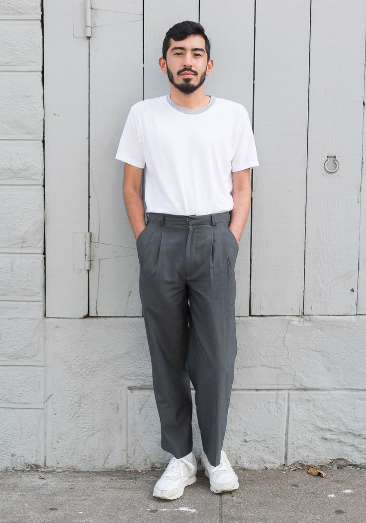 """Sebastian,24""""I'm wearing a tee from Uniqlo, trousers from Thrift Town, and Reebok classic sneakers. My go to look is always a simple tee tucked into some high waisted and usually oversized trousers. Most of my inspiration comes from the 1950's and things my Dad wore while I was growing up.""""Aug6,2016 ∙ The Mission"""