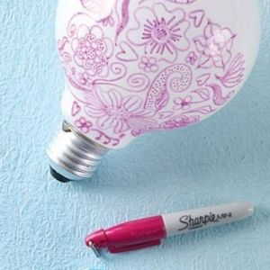 Draw on a light bulb with a Sharpie and it will decorate