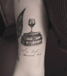 Glass of wine on books by Kane Navasard