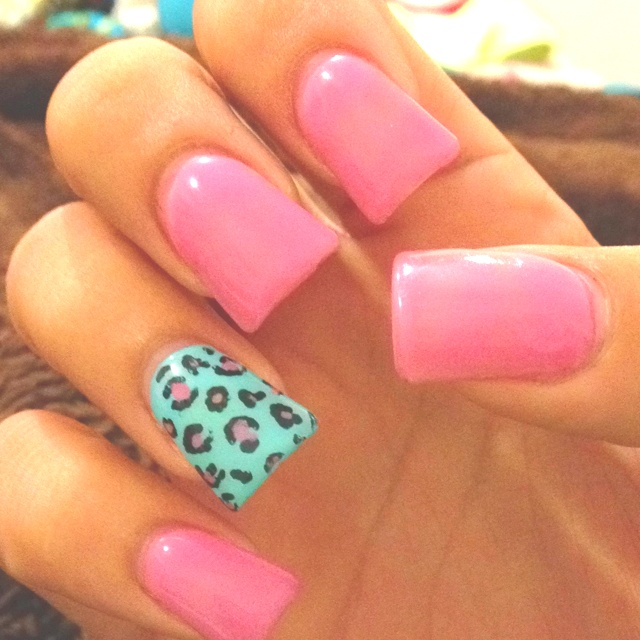 wide nails that are blue and pink with a cheetah statement