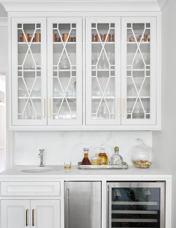 Chic Wet Bar Features White Cabinets Topped With Marble Fitted A Round Sink And Polished Nickel Faucet Placed Next To Stainless Steel Mini