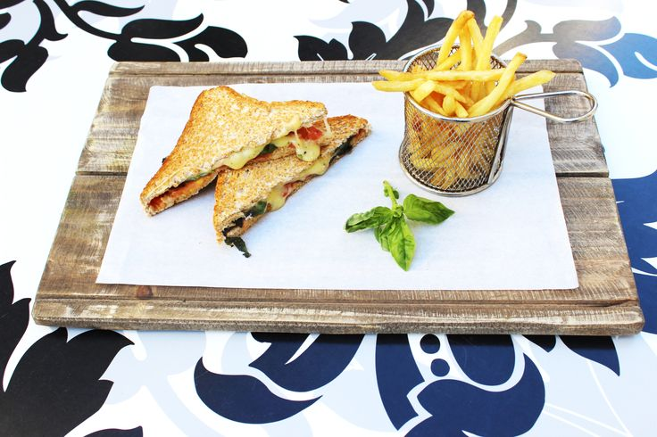 Caprese Toasted Sandwich R 65.00 / or ± $6.50 Ripe Tomato, Fresh Basil, and Creamy Mozzarella To stay at The Hyde Hotel contact us below on the email. phone click the photo 13 London Road Sea Point 8001 Cape Town, Western Cape Always open Phone021 434 0205 Emailreception@thehydehotel.com #tasty #cheese #sandwich #toasted #tasty #delight #garden #salad #Chips #Slapchips #Chippies