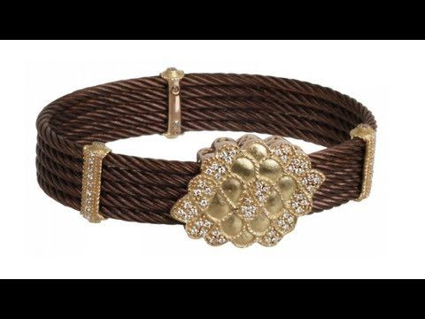 To buy now click on the link: http://shrsl.com/?~3fr0  The #Charriol Celtique #18k #Yellow #Gold and #Bronze #Cable Floral #Bangle features #bronze #cables with #18k #diamond encrusted yellow #gold bars with a 18k yellow gold floral center with #diamond accents. All #diamonds are .54ct and magnetic closure makes this stunning bangle a great fit for a small to medium wrist.#International #Luxury #Jewelry Brand, Charriol, was founded in Geneva, Switzerland in 1983 by French