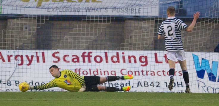 Queen's Park's Wullie Muir saves in action during the Ladbrokes League One game between Peterhead and Queen's Park.