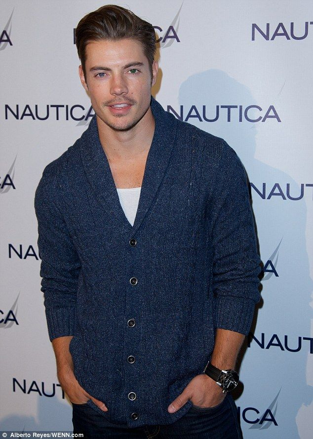 Gorgeous: The Dallas heartthrob was looking GQ chic in navy-blue cardigan