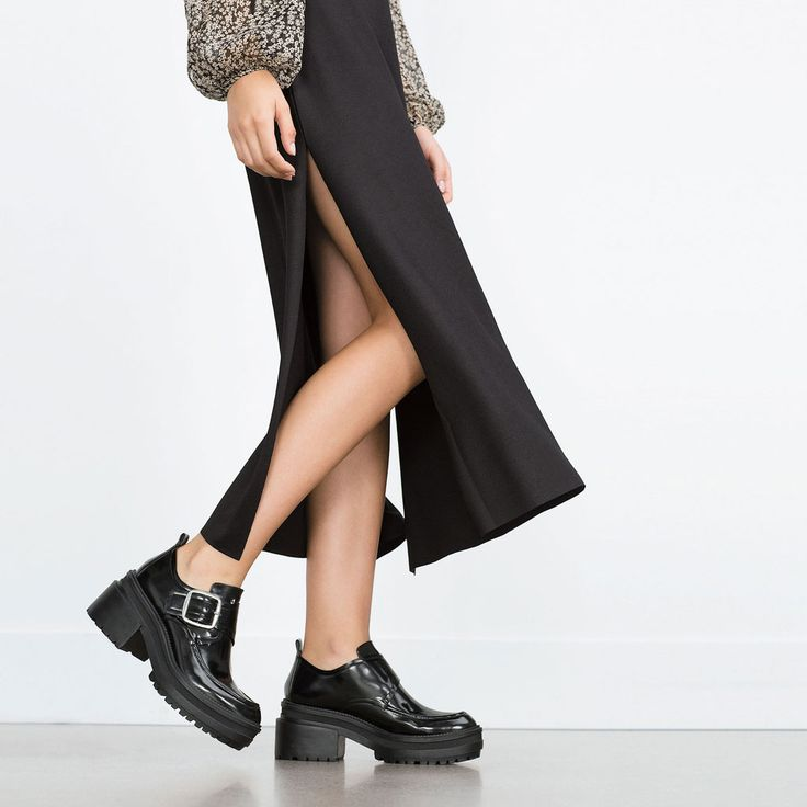 FLAT ANKLE BOOTS WITH BUCKLE