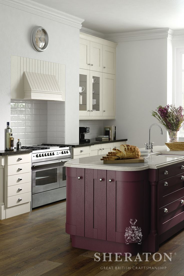 Traditional painted shaker kitchen shown here in Ivory with a stunning Aubergine island feature.  This kitchen is available in a range of other colours.  Please see http://www.sheratonkitchens.co.uk/kitchens/painted-wood-shaker for more details.