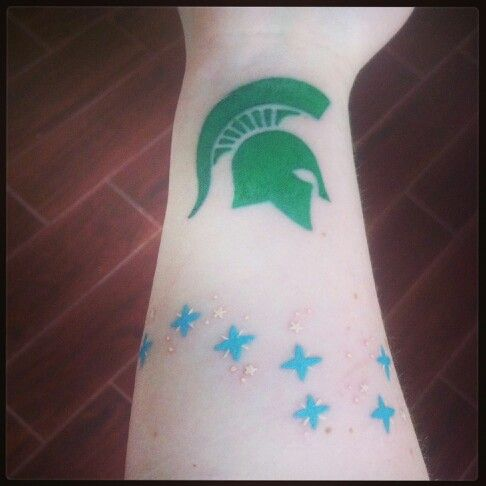 Sparty tattoo on the inside of my wrist, freshly done, and Big Dipper tattoo on my forearm, freshly touched up. Done by Miss Mae La Roux at Sacred Tiki in Visalia, CA. #missmae #tattoo #spartanink #sparty #spartan #spartans