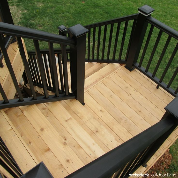 Black railing with a cedar boards inspires a modern look for a classic deck design. | 7 Deck Rail Ideas For Your Cedar Deck