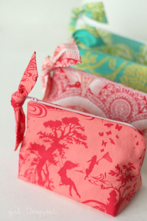 """You know how you see a project flash across your computer screen and you just can't stop thinking about it? When I saw Kate's """"Little Zippered Bow Pouch"""" tutorial, I knew I needed to make a few for the girls. These little bags sew up in no time and they are adorable. They're really quite …"""