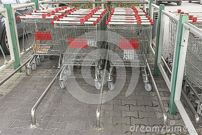 Shopping trolleys before entering at hypermarket in Krakow.Poland.