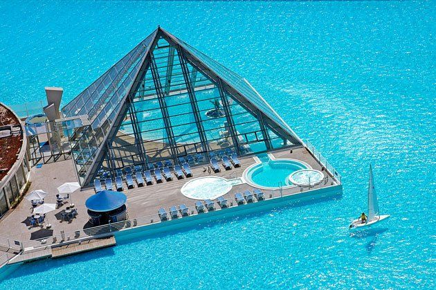 Wow!!!  A place I'd love to visit:)  Largest pool........San Alfonso del Mar resort in Algarrobo, Chile.  Half a mile long and filled with 66 million gallons of water..........