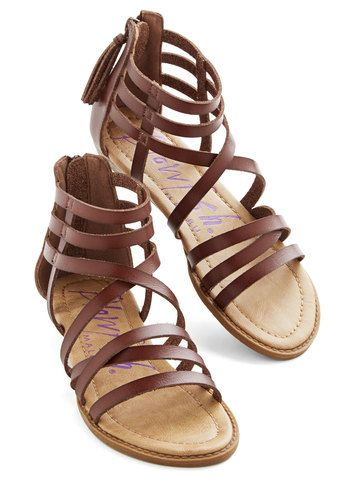 Up with the sun, you're feeling positively cheerful as you head out the door in these brown sandals from Blowfish! You're putting your best foot forward in this woven pair, which showcases a strappy silhouette and a zip closure. Pair these boho, chocolate-hued flats with a crocheted skirt and a breezy blouse to complete a winsome look that can't be beat! More