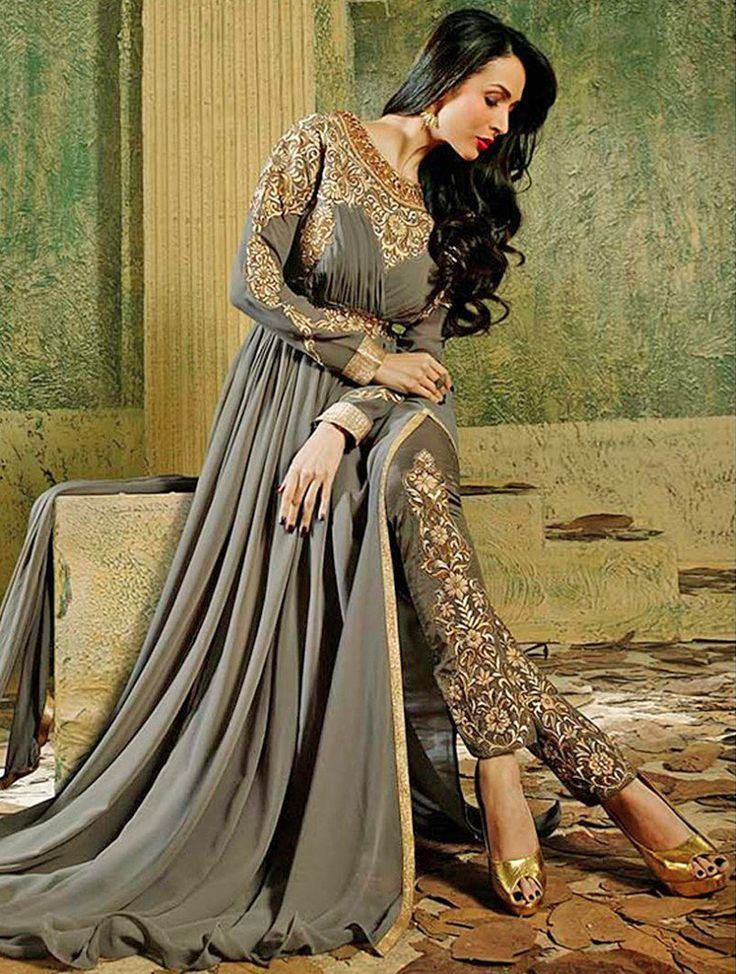 Don't let eyes off you by getting dressed in this everstylish glossy Malaika Arora Khan designer floor touch gown style dress with embroidered bottom. Superb designing is done on the sleeves, back and neck with zari and embroidery. Waist embroidery patch provided separately.