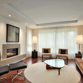 contemporary living room with wall to wall and floor to ceiling ripple fold pleated curtains