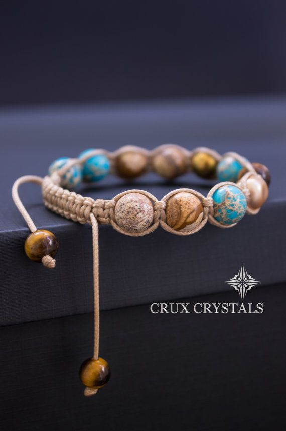 Hand crafted Shamballa Bracelet made of 10mm Mixed Natural Stone Beads and Swarovski Elements - Swarovski Crystal Pearls Baroque, Picture Jasper, Light Blue Emperor Jasper, Gold Plated Faceted Hematite, Faceted Tigers Eye, all combined with tan beige waxed shamballa cord. The item ends