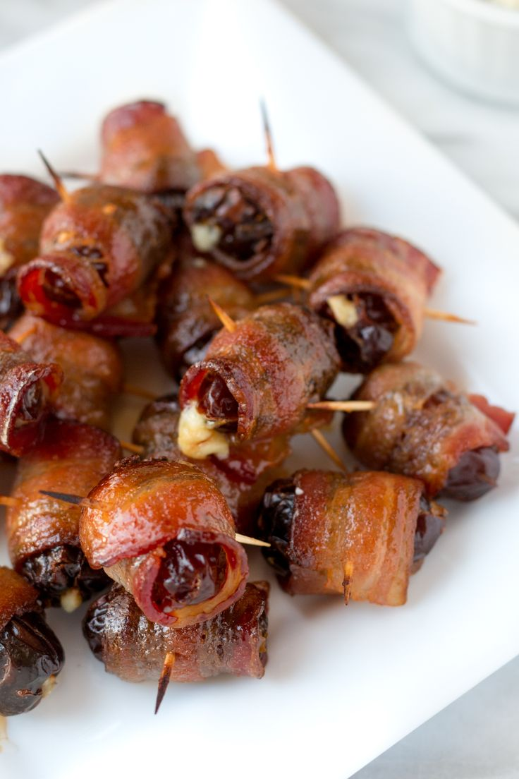 Dates stuffed with blue cheese, wrapped in bacon, and crisped with a Maple-Sriracha glaze. Maple Sriracha Devils on Horseback are a perfect party snack!