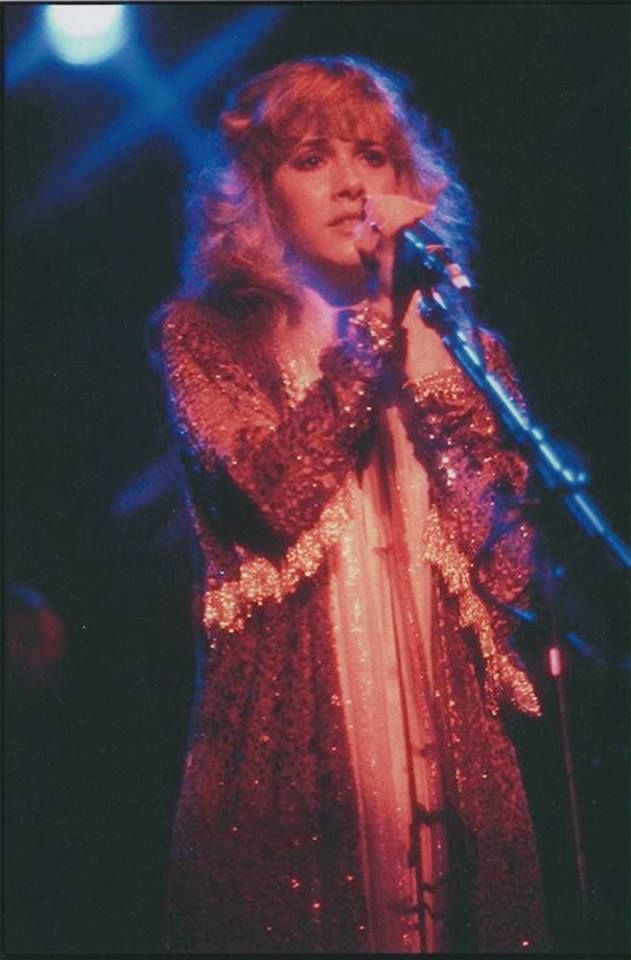 beautiful Stevie ~ ☆♥❤♥☆ ~ onstage with a troubled expression; photo taken during one of her Bella Donna concerts, 1981