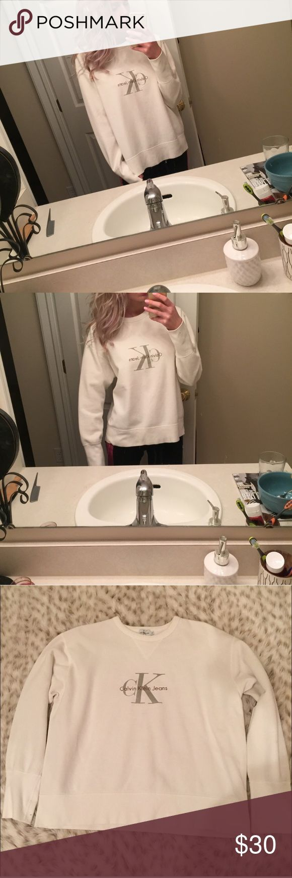 Vintage Calvin Klein Pullover Sweatshirt Vintage Calvin Klein size medium sweatshirt! Trendy and on point! Overall great condition besides on right sleeve at the end! Small little markings. See pic for details. Not noticeable when wearing! Great with jeans or leggings! Unisex! Calvin Klein Tops Sweatshirts & Hoodies