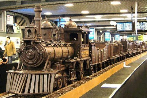 A train made entirely of chocolate has set a new Guinness World Record as the longest chocolate structure in the world...... The sculpture, on display at the busy Brussels South station, is 112-feet (34.05 meters) long and weighs over 2,755 pounds (1250 kilos).Maltese chocolate artist Andrew Farrugia spent over 700 hours constructing the masterpiece.