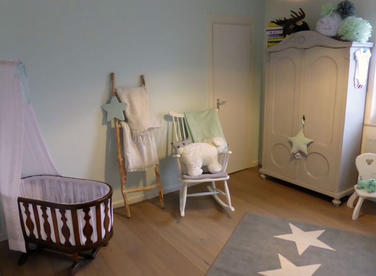 Baby room in green mint and grey (soft tones). With white rocking ...