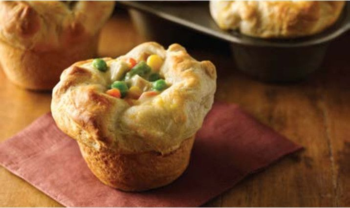 2 cups frozen mixed vegetables thawed, 1 cup diced cooked chicken 1 can (10.75 oz.) condensed cream of chicken soup 1 can (16.3 oz.), Pillsbury Grands Flaky Layers refrigerated biscuits. Press biscuits into greased muffin pan & fill. Bake at 375°F 20 to 22 minutes or until biscuits are golden brown.