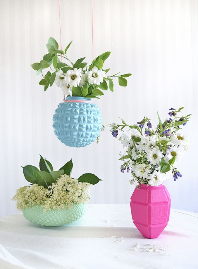 Glass lampshades repurposed as vases.