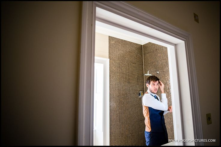 Finishing touches for the Groom at this Botleys Mansion wedding -