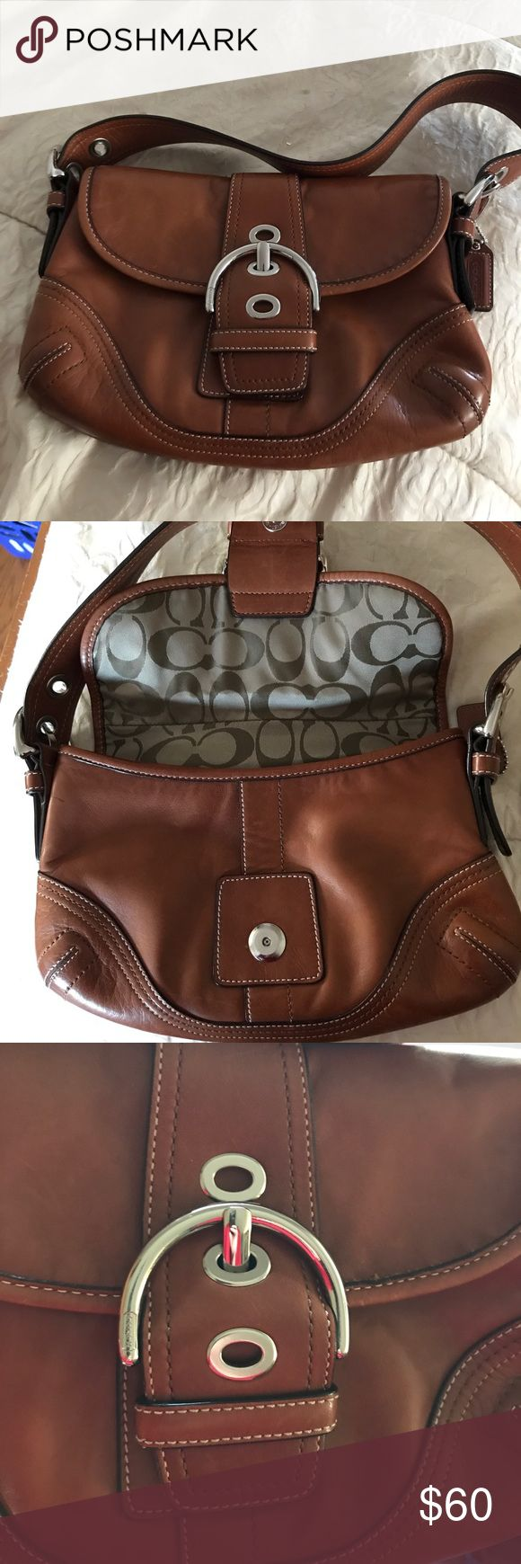 """Coach SOHO Leather handbag EUC Authentic Coach """"Soho"""" shoulder bag. Medium size with silver buckles. Tan/Brown leather and signature jacquard fabric inside There is an outside pocket, and the straps adjust. Large leather buckle flap. Coach Bags Shoulder Bags"""