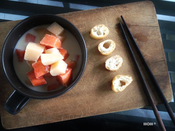Two-Tone Fruit Salad ©WOW  papaya & cantaloupe. in cold soy milk, with Youtiao (deep-fried doughstick, served sliced)