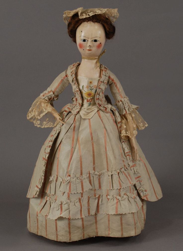 Georgian Wooden Doll There is no doll like a Georgian Wooden that is capable of adding such a large degree of grace and warmth to a room. This elegant nineteen and one-quarter inch lady, from the era of George II circa 1740, is no exception.