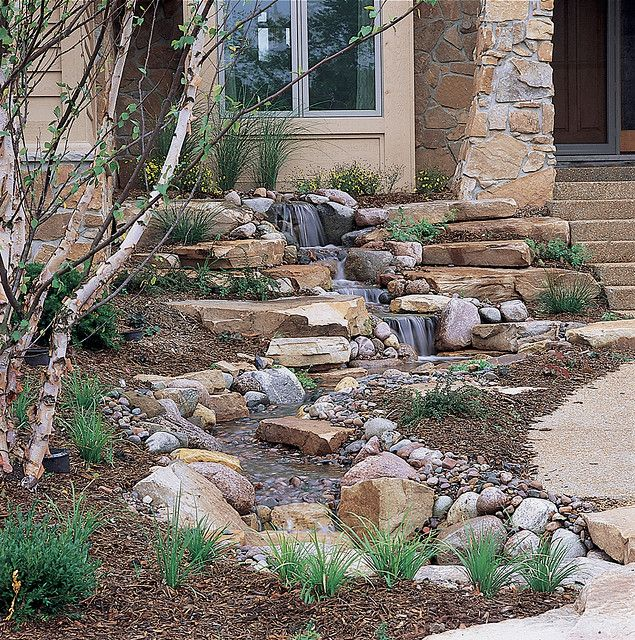Pondless waterfall ... Of course, in our yard this would be a dry bed xeroscape since we live in the desert. Still, it would add height to an otherwise level lot