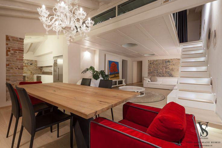 Attic renovation. Briccola table, Murano clear lamp, custom metal stair. Custom fabrics for chairs and sofa.