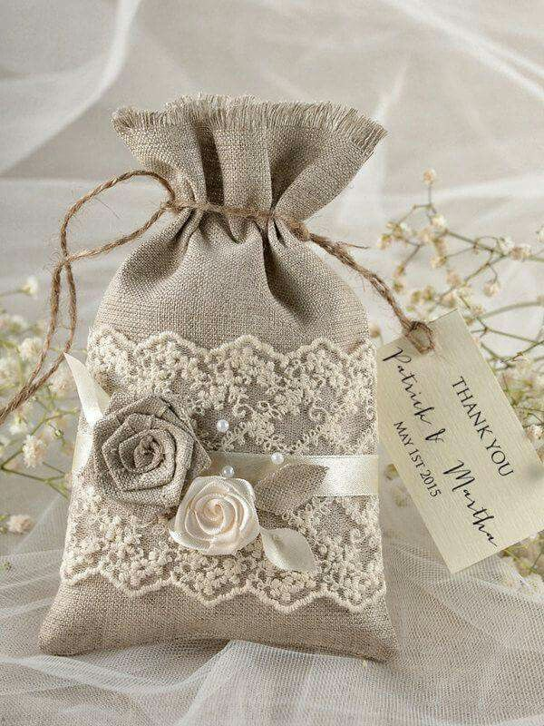 I like the placement of the lace on the pouch, less crazy about the rosettes and twine. RIA//