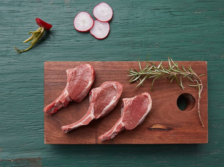 Meat tray Fresh chops ready for the bbq. Chopping board by wah.works. Photo by Dani Knox Photos